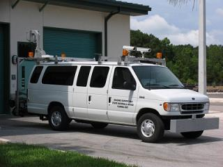 Imaging survey van used by the state materials office of the Florida DOT. The profiler is the grey/silver box attached on the front bumper.