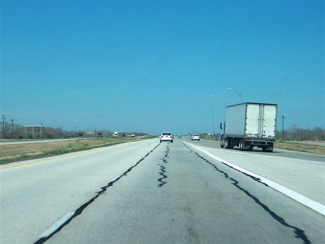 Crack sealing on I-37 near San Antonio, TX to repair top-down cracks.