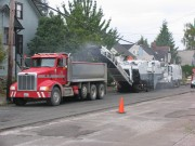 Figure 2. End dump truck receiving milled pavement from a milling machine.