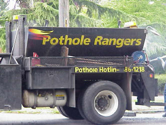 Pothole patching truck with a hotbox