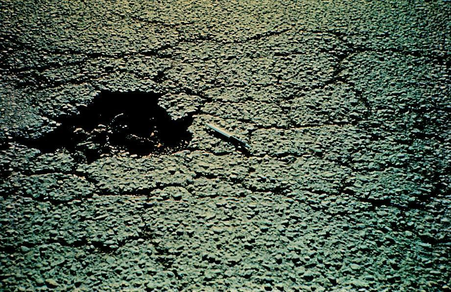 Pothole as a result of fatigue cracking.