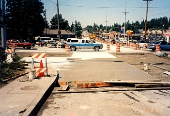 Construction staging using fixed form paving.