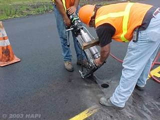 Taking a Pavement Core for Density Quality Control