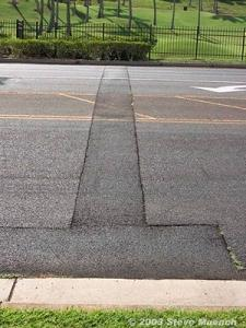 Right: Larger Utility patch across an arterial. Notice that the patch edges are separated from the surrounding pavement. These edges need to be crack sealed to prevent water infiltration into the subgrade.