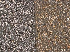 Two adjacent SMA pavements at the NCAT Test Track near Auburn, AL. The pavement on the right uses river rock, which is more susceptible to abrasion, as its aggregate and is showing some signs of aggregate polishing.