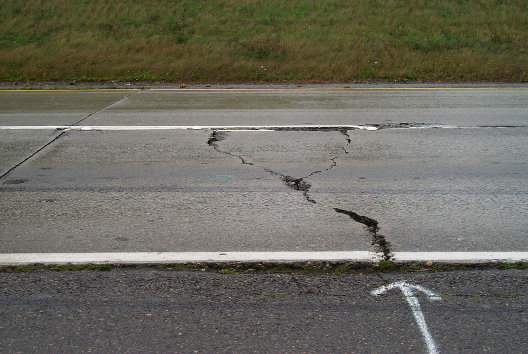 Large panel cracks on highway.