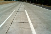 Figure 7. Joints sealed with hot-pour liquid sealant on a freeway on-ramp (normally, joints should coincide with lane divisions as they do near the horizon of this photograph).