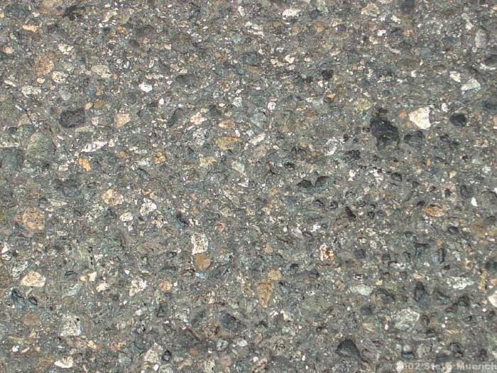 This close-up picture of a road surface shows aggregate wear after about 5 years of wear.