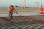 Figure 2 Airblasting to clean the concrete surface