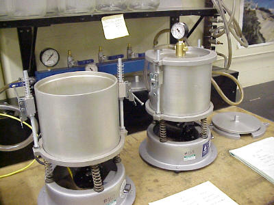 Containers Used to Agitate and Draw a Vacuum on Submerged TMD Samples