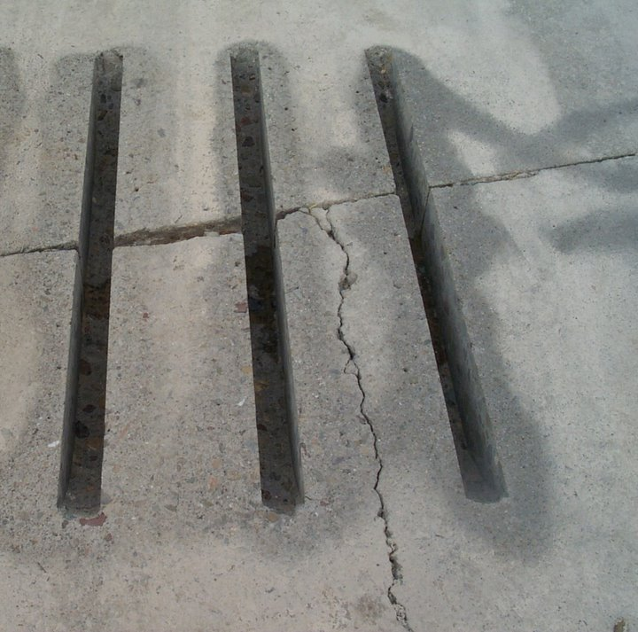 Dowel bar slots aligned to miss an existing longitudinal crack.