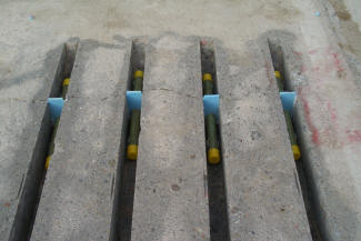 Dowel bars placed in slots as part of a retrofitting project.
