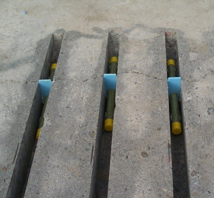 Dowel bar assembly at a transverse crack.
