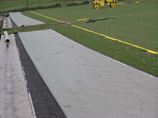 Permeable soccer field - artificial turf over open-graded aggregate.