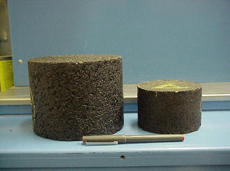 Superpave gyratory compactor sample (left) vs. Hveem/Marshall compactor sample (right).