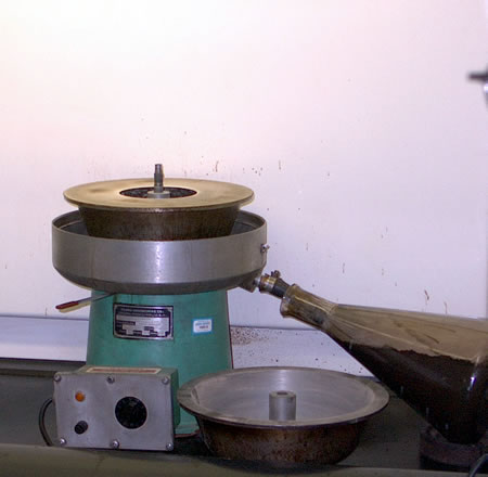 Uncovered centrifuge used in a solvent extraction method.