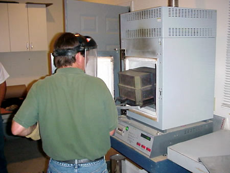 Inserting the sample into the hot ignition oven.