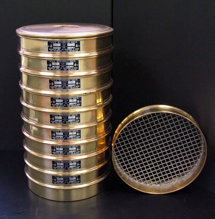 Stacked sieves used for a gradation and size test.