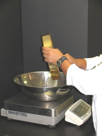Weighing the aggregate retained on a sieve