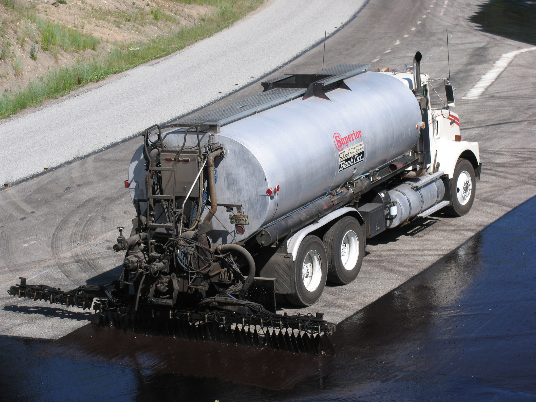 Tack truck applying an asphalt emulsion.