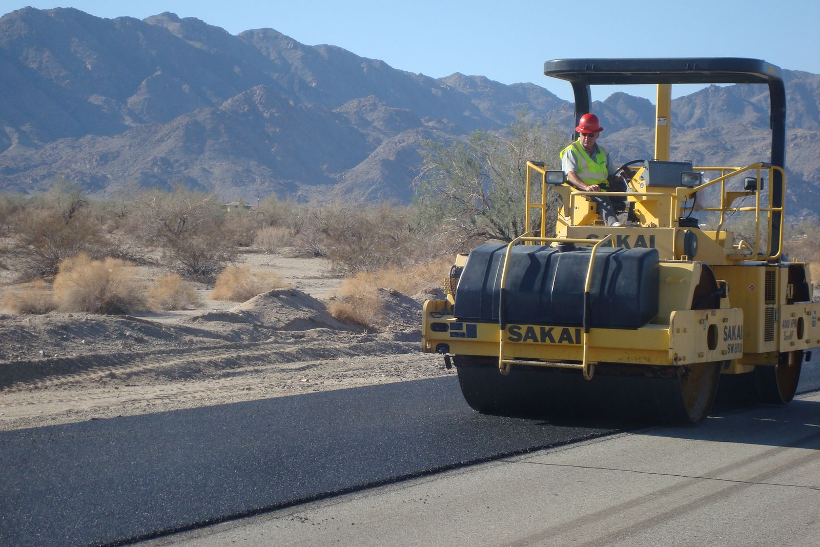 Compaction of a thin asphalt overlay.