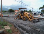 Backhoe used to place and initially grade spots